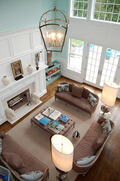 beautiful trimmed room; huge fireplace, french doors, wide open space!