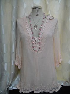 Light pink blouse.  Super cute and lightweight!  Size large
