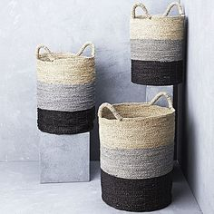 Transform your laundry space with the handy storage of the Striped Seagrass Basket with Handles from Inartisan.