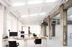 The LYCS Architecture office in Hangzhou, China, turned a storage space into minimalist heaven.