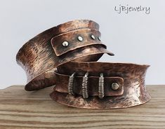 Hammered Concave, 'anti-classic' Bangles by Laura Jane Bouton of LjB Designs. Copper & sterling silver.