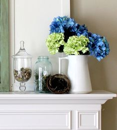A classic looking mantle from The Inspired Room. Love the hydrangeas in the white pitcher.