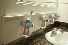 Mason Jar Storage.  I don't think I'd have a tube of toothpaste per person, but this could be cute for a lot of things in the bathroom...qtips, cotton balls, bobby pins, etc.