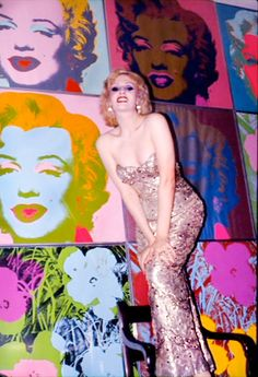 Candy Darling with Warhol's Marilyn & Daisies.