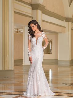 Justin Alexander Style 8870: Beading incorporated into vintage lace details appear throughout the Sabrina neckline, lace appliqués on the sheer sleeves, low illusion back, to the chapel length train that is designed for the confident bride.