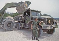 Soldier guards M51 Truck, Dump, 5 ton, 6x6 while loading, 1 March 1980