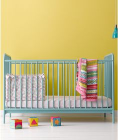 Mothercare Carnaby Cot Bed- Turquoise. Made with a sleek and stylish metal frame, the Mothercare Carnaby cot bed will add a bold pop of colour to your baby's nursery for a fresh, effortlessly trendy look.
