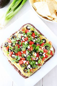 Mexican Layer Dip Recipe on twopeasandtheirpod.com This 7 layer dip is always a hit at parties and it is easy to make too!