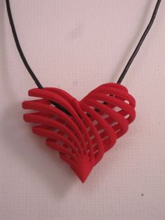 3d printed jewelry My twisted heart pendant by CreativeUseofTech