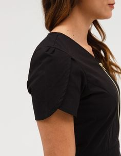 The Tulip Top in Black is a contemporary addition to women's medical scrub outfits. ShopJaanuufor scrubs, lab coats and other medical apparel.