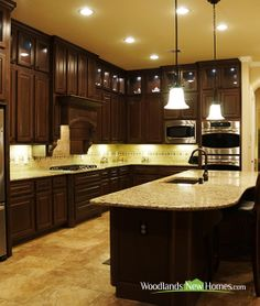 Kitchen features wooden #cabinets, #granite #countertops and stainless steel appliances.