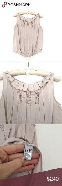 Diane von furstenberg silk tank Very good pre loved condition. No marks or pulls- only damage is a couple of places the pleats need to be re-tacked. I'm not a seamstress, but we are talking about literally one or two stitches. Diane Von Furstenberg Tops Tank Tops
