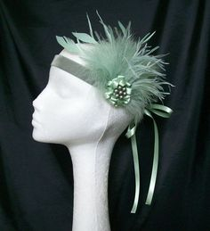 Pale Sage Sea Green Feather & Pearl Vintage by IndigoDaisyWeddings, £22.50 Order Now from www.indigodaisyweddings.co.uk Specialising in stunning bespoke cocktail fascinators and formal hats in a wide range of colours, perfect for Royal Ascot and The Kentucky Derby. Plus all your wedding floral accessories including shoe clips, vintage flapper bands, feather and flower fascinators, feather fans, fairy wands, wrist corsages, wedding bouquets & buttonholes. Worldwide Delivery.
