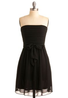 Crushing on this simple black dress, would definitely be appropriate for the fam at the holidays
