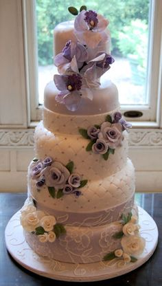 Orchids and roses on a Victorian inspired cake.