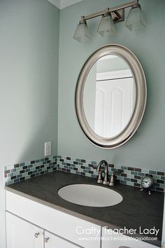 add a strip of glass back splash to the bathroom for added color and texture