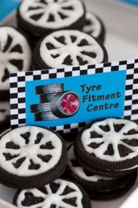 "Cars, boats, planes and trains party: These ""tyres"" are so easy to make. Use Oreo biscuits with wheel spokes piped on in royal icing."