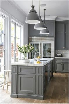 Susan Greenleaf San Francisco Home A Clic Kitchen With French Doors Gray Cabinetry Sub Zero Refrigerators Pendant Lamps And Carrera Oro Marble