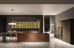 Modular kitchen model with lacquered brushed bronzed doors combined with bronze frames and back light.