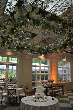 This amazing custom made hanging piece is filled with tulips and hydrangea, dripping with candle votives. Such a unique piece, available for rent @ www.hollidayflowers.com
