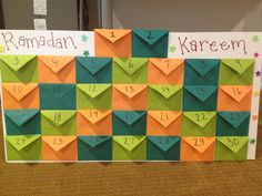 Ramadan Advent Calendar: each flap reveals a hadith to learn or a good deed to perform. the envelope holds money to put in the masjid sadaqah daily.