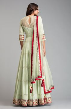 COM - Shop For Luxury Indian Designer Clothing Online - - Mukaish Pista green anarkali with contrast of red clubbed with a chudidar and mukaish net dupatta. Fabric: Cotton Mal Source by indiaspopupcom Indian Gowns, Indian Attire, Pakistani Dresses, Indian Wear, Indian Outfits, Indian Clothes, Kurti Neck Designs, Lehenga Designs, Blouse Designs