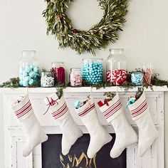 Make Christmas even sweeter with jars full of colorful candy. Chocolate, cinnamon candies, peppermints, you name it. This mantel decor is something every sweet tooth can get on board with.  /