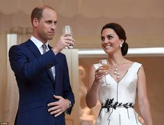 Cheers! The Duchess of Cambridge wore a black and white ensemble with a plunging neckline,...