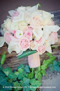 This gorgeous bouquet features soft pink roses and white calla lilies.