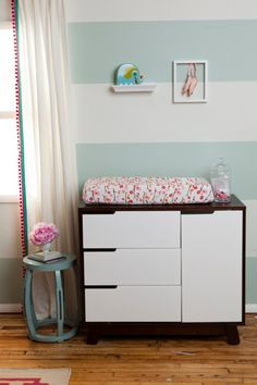 A springtime birdie nursery featuring a gray and white striped accent wall, birdie crib bedding, modern accents, graphic artwork and a border frame rug. Chic Nursery, Nursery Room, Boy Room, Girl Nursery, Kids Room, Pink Striped Walls, Striped Room, Aqua Paint, Layla Grayce