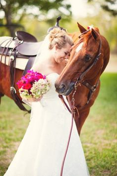 Picture with horse in wedding dress if i ever get married , damn right there will be a horse involved in the wedding!