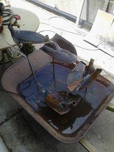 garden shovel water fountain in wheelbarrow reuse rethink repurpose recycle