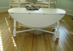 "Pretty Shabby Chic Vintage Round Dropleaf Coffee Table $135 - For Sale: Pretty Shabby Chic Vintage Round Drop Leaf Coffee Table....painted white & nicely distressed to bring out all it's cottage charm. Opens up to 40"" in diameter....pretty opened or closed. Would make a great addition to your cottage style home.    Dimensions: 40"" when table is opened  20 1/2"" X 40"" when leaves are down  17"" High…"