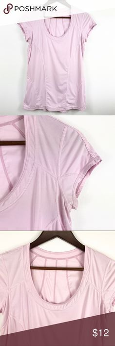 """Zella - Athletic Pink Short Sleeve Shirt (148) Excellent used condition! No flaws. Pale Pink Zella workout shirt. Super lightweight & comfy!   Fitted Design Scoop Neckline Short Sleeves  86% Polyester 14% Spandex  Approximate Measurements Laying Flat: Shoulder- 14 1/2"""" Bust- 18 1/2"""" Length- 27""""  •Pet & Smoke Free Home •No Trades •BUNDLE DISCOUNT🛍  Feel free to make offer or ask questions! Thanks for visiting my closet! Zella Tops Tees - Short Sleeve"""