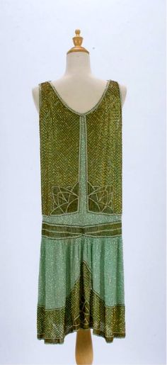 vintage flapper style dress in two-tone green with crystal beading detail.
