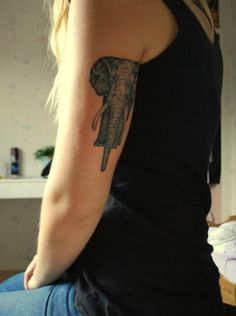 (placement) elephant tattoo, detailed image,  back of upper arm