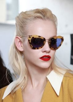 miu miu: love the sunglasses, the bold red lip and the goldenrod color of the blouse