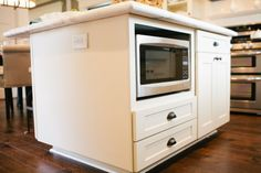 Great idea! Add a built in microwave to you kitchen island. #DreamBuilders