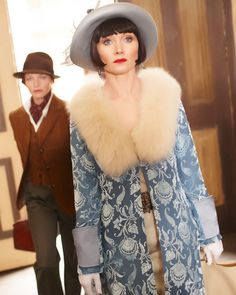 Miss Fisher (played by Essie Davis) is thoroughly independent, both financially and in spirit. In the first episode, she climbs a building's wall and merely ...