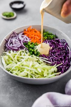 Angled shot of coleslaw sauce being poured into a bowl containing freshly shredded cabbage, carrots, jalapeños and red onions - step 3 in the recipe to make Spicy & Sweet Jalapeno Coleslaw. Coleslaw Sauce, Jalapeno Coleslaw, Coleslaw Recipe Easy, Spicy Coleslaw, Coleslaw Recipes, Homemade Coleslaw, Red Onion Recipes, Cabbage Salad Recipes, Jalapeno Recipes
