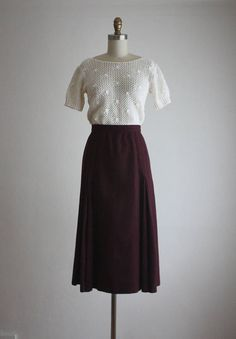 vintage dark plum wool skirt with a long, flared shape. unlined. zip and clasp closure. medium/large wool made by evan picone waist 30 hips 44 length 31 in excellent vintage condition with only minor wear (one tiny mend on the hip)