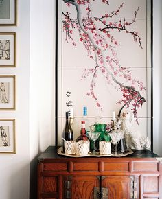 A hand-painted silk folding screen frames the living room's bar while accentuating the high ceilings.