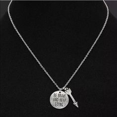 "Silver Message Pendant Necklace LOVELY, Fashionable & Beautiful Simple Silver Alloy Chain Necklace with Circle Pendant inscribed ""BE BRAVE AND KEEP GOING"" and Arrow Charm. Lobster Claw Closure, Approx. 18"" LongPRICE IS FIRM UNLESS BUNDLED Boutique Jewelry Necklaces"