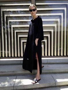 Black sheath kaftan + black Hermes Oran sandals + black sunglasses :: Elin Kling