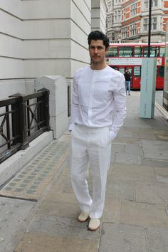 An all white ensemble - a daring choice but he has pulled it off perfectly!