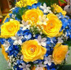 Bridal bouquet of yellow roses, blue hydrangea, stephanotis with diamond pins and baby's breath.  doristhefloristt.com