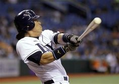 Tampa Bay Rays' Hideki Matsui, of Japan, hits a first-inning, two-run home run off Baltimore Orioles starting pitcher Wei-Yin Chen during a baseball game on Friday, June 1, 2012, in St. Petersburg