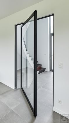 Glass pivoting door with black anodized aluminium - ANYWAYdoors Pivot Doors, Internal Doors, Home Interior Design, Interior Architecture, Aluminium Doors, Diy Room Decor, Home Decor, Office Interiors, Windows And Doors
