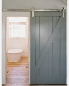 The laundry room double barn door install is underway! And I'm trying desperately to avoid hovering during install, but the excitement is getting the best of me. I was inspired by the style and color of this @fourchairsfurniture space and barn door, so now I'm 4 color pots of samples in trying to nail this pretty gray-teal-blue shade, but I think I may have a winner! Fingers crossed. #inspiration