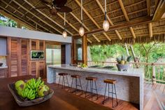 Captivating Tropical Kitchen Design that blurs the line between inside and outside #kitchen #tropical #treehouse #homedesign #outdoorliving